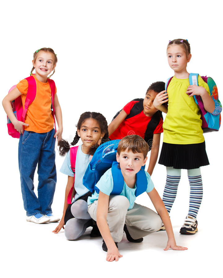 Children group with backpacks royalty free stock images