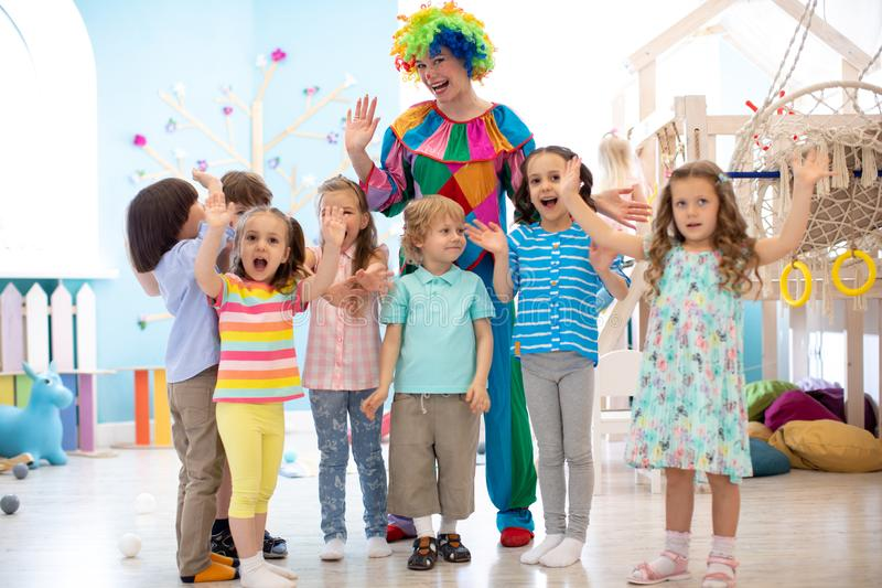 Children group with clown celebrating birthday party royalty free stock photography