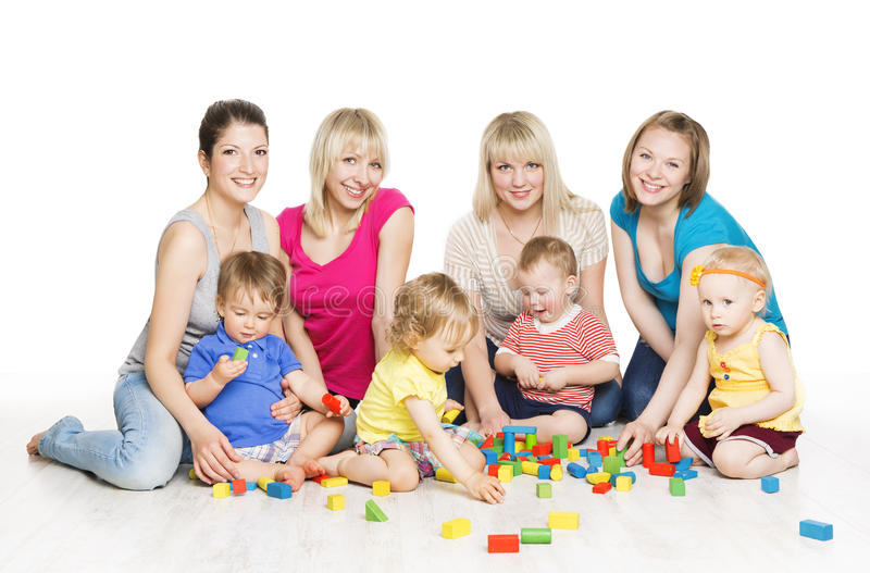 Children Group with Mothers Playing Toy Blocks. Little Kids Earl stock photos