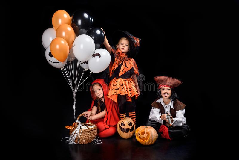 Children with halloween balloons royalty free stock photography