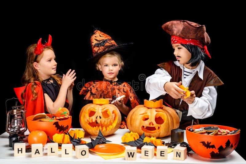 Children with halloween pumpkins stock photo