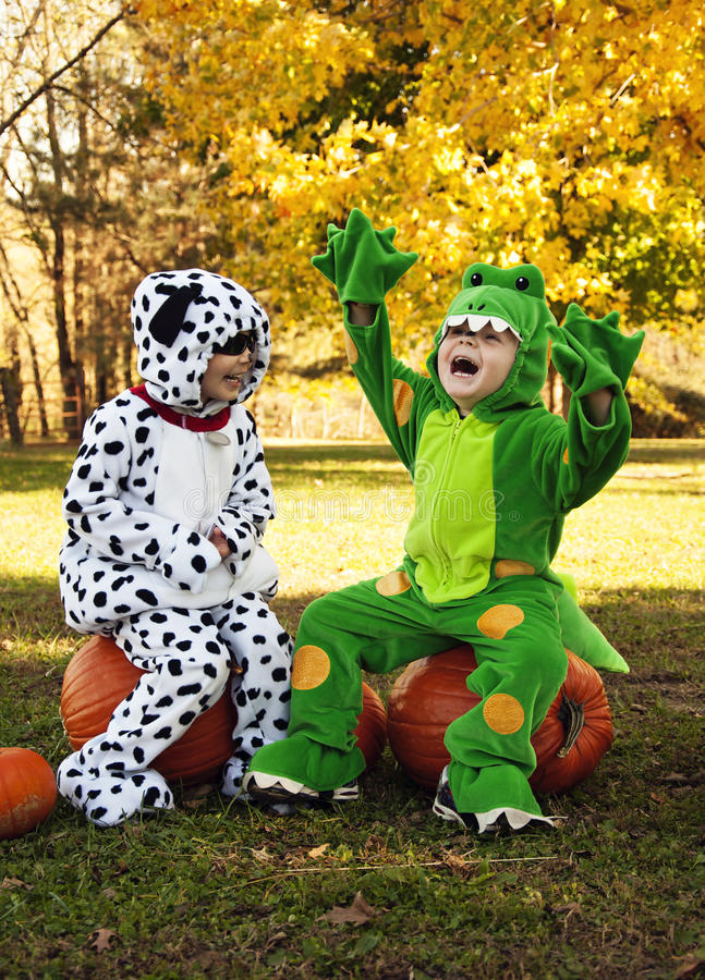 Children in costumes having fun royalty free stock photography