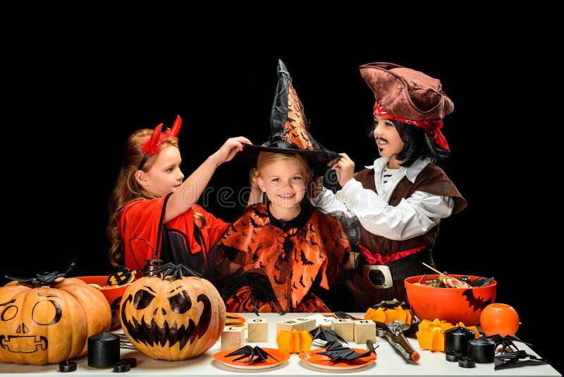 Children in halloween costumes with sweets royalty free stock photography