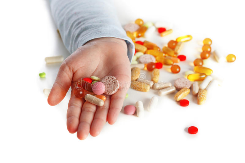 Children hand with different pills stock images