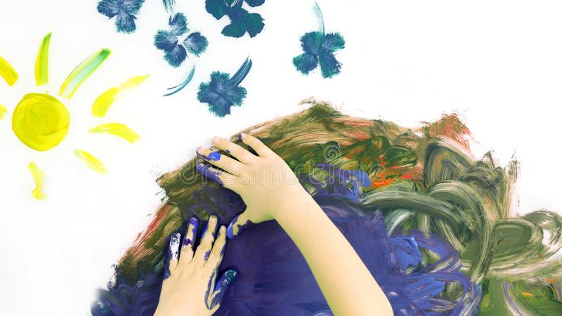 Children hand paint a picture with paints on white background royalty free stock images