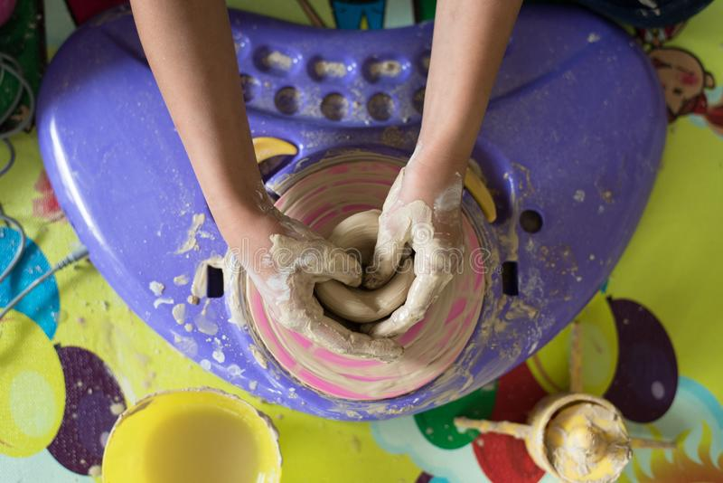 Children hand playing with clay to make pottery stock image