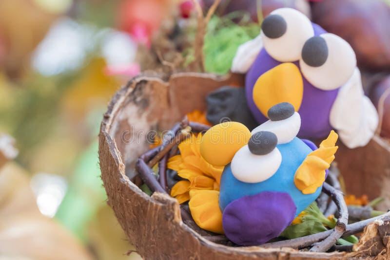 Children crafts - birds in the nest stock photo