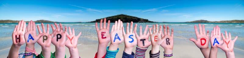 Children Hands Building Word Happy Easter Day, Ocean Background stock photography