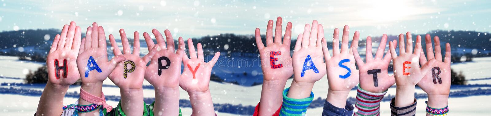 Children Hands Building Word Happy Easter, Winter Scenery royalty free stock photography