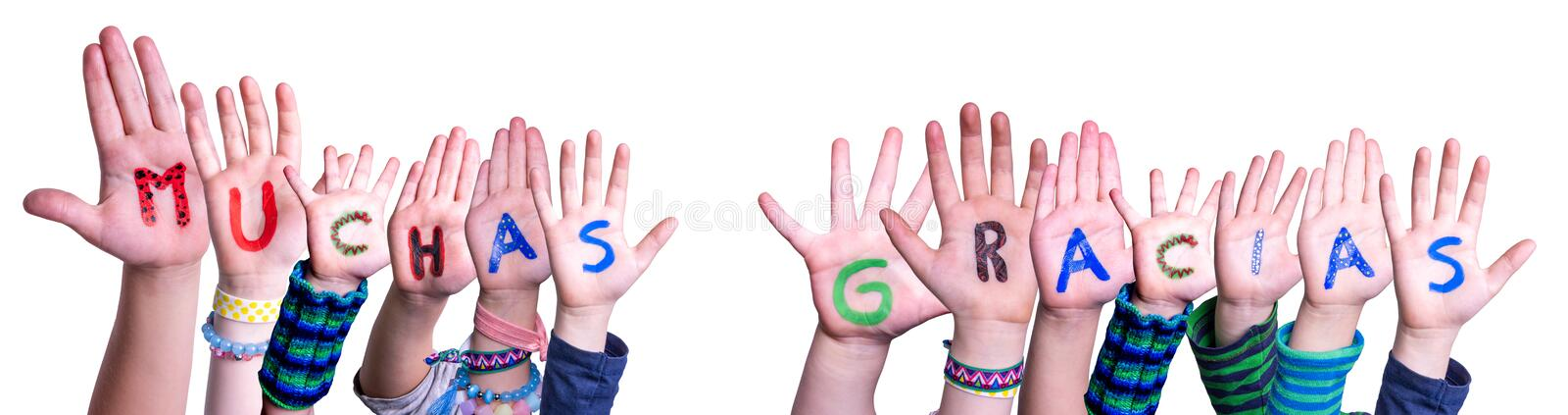 Children Hands Building Word Muchas Gracias Means Thank You, Isolated Background. Children Hands Building Colorful Spanish Word Muchas Gracias Means Thank You royalty free stock photography