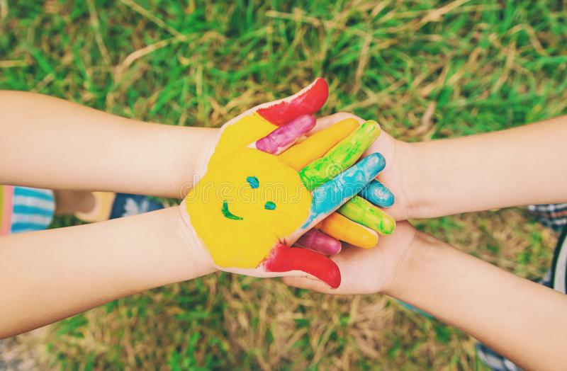 Children hands in colors. Summer photo. Selective focus stock photography