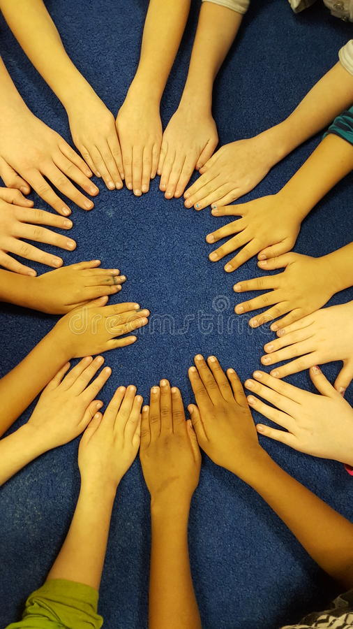 Children Hands have fun on the rug royalty free stock photography