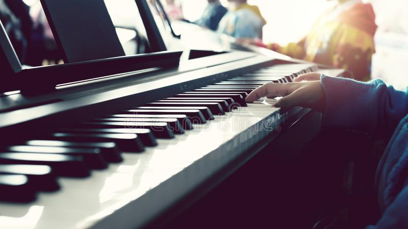 Children hands on the piano. Music for Kids concept royalty free stock photo