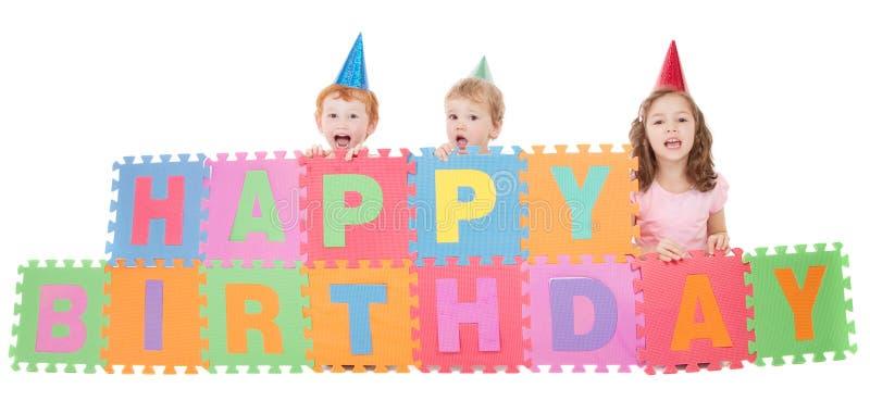 Children with happy birthday kids sign stock photos