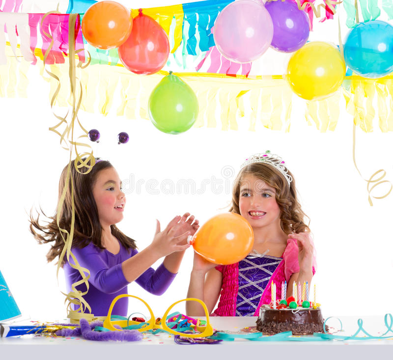Children happy birthday party girls with balloons. And chocolate cake royalty free stock image