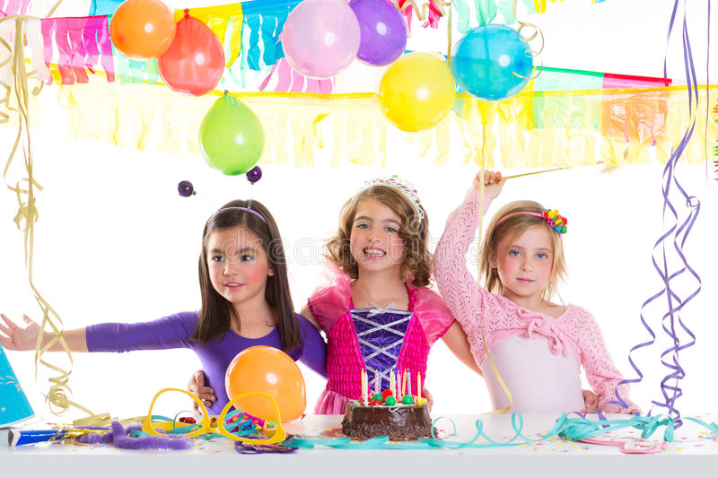 Children happy birthday party girls group. With balloons and chocolate cake royalty free stock images