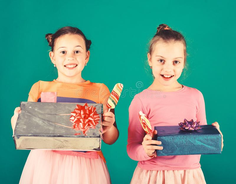 Children with happy faces pose with candies and presents stock image
