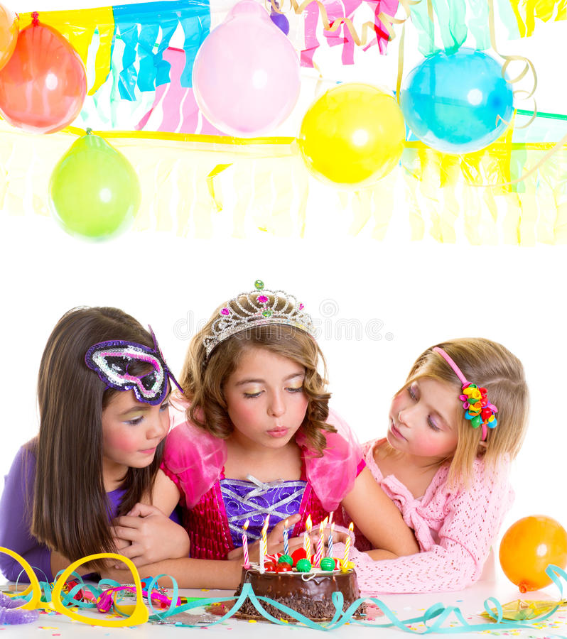 Children happy girls blowing birthday party cake. Children happy girls blowing birthday party chocolate cake candles stock photography