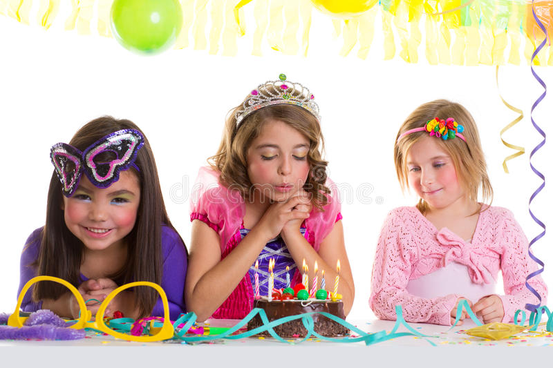 Children happy girls blowing birthday party cake. Children happy girls blowing birthday party chocolate cake candles stock images