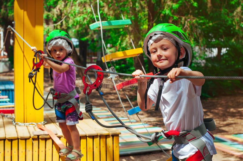Children exploring an adventure rope park outdoor stock images