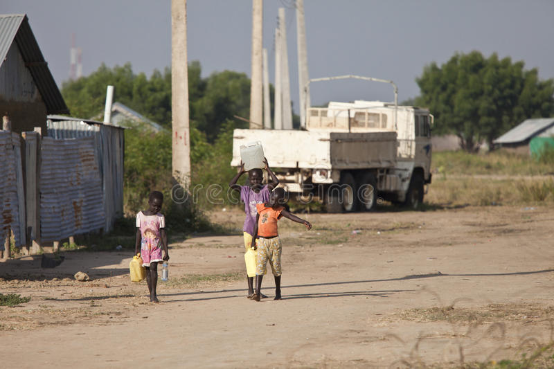 Children hauling water, Bor Sudan royalty free stock images