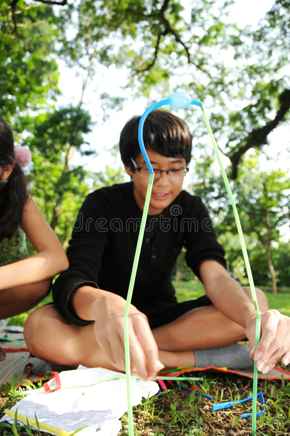 Children Having Fun Building Toys In The Outdoor Stock Photos
