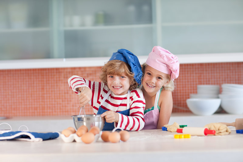 Children having fun in the Kitchen royalty free stock photo