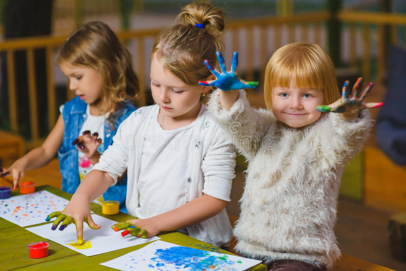 Download Children Having Fun Painting With Finger Paint Stock Photo - Image: 78946530