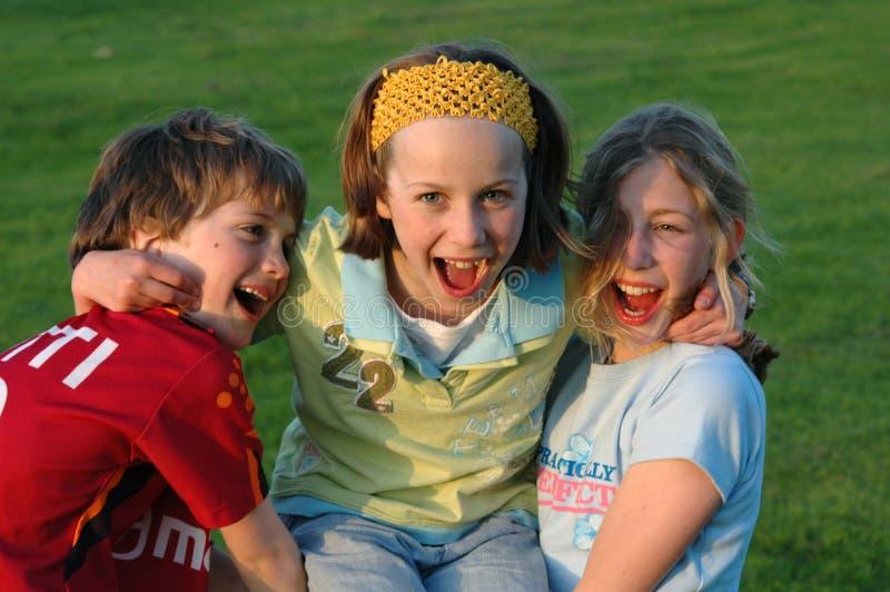 Children having fun in the park. Portrait, group, three children, outdoors, landscape, Nikon D70 royalty free stock photos
