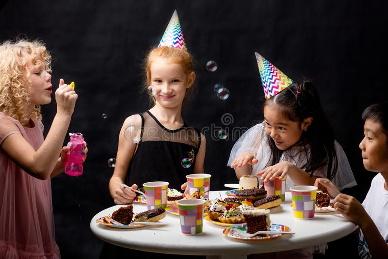 Children are having fun with ssoap bubbles on holiday stock photos