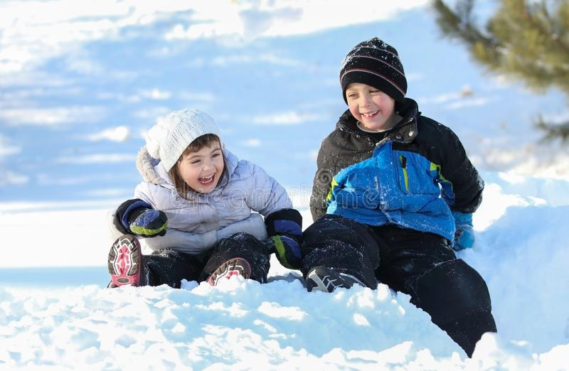 children in snow during winter royalty free stock image