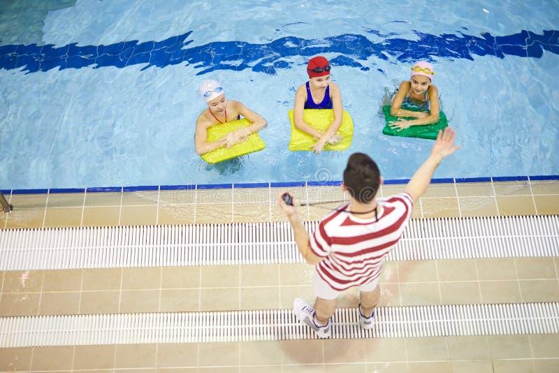 Children having swimming lesson royalty free stock photos