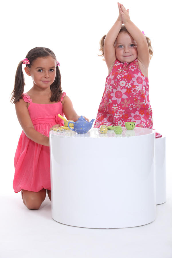 Children having a tea party stock image