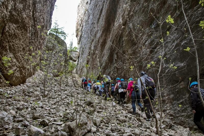 Children hiking among rock formations royalty free stock photo