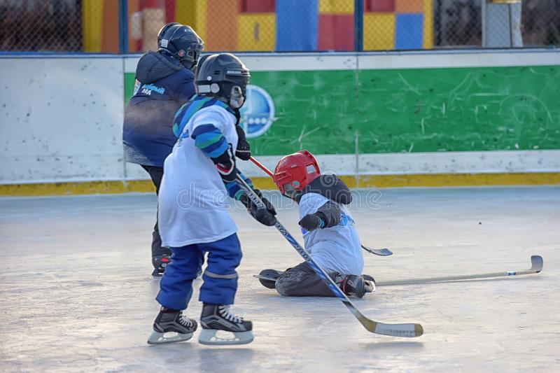 Children with hockey sticks playing hockey at the festival. Russia, Severodvinsk 27,11,2016 Children with hockey sticks playing hockey at the festival `Hockey royalty free stock image
