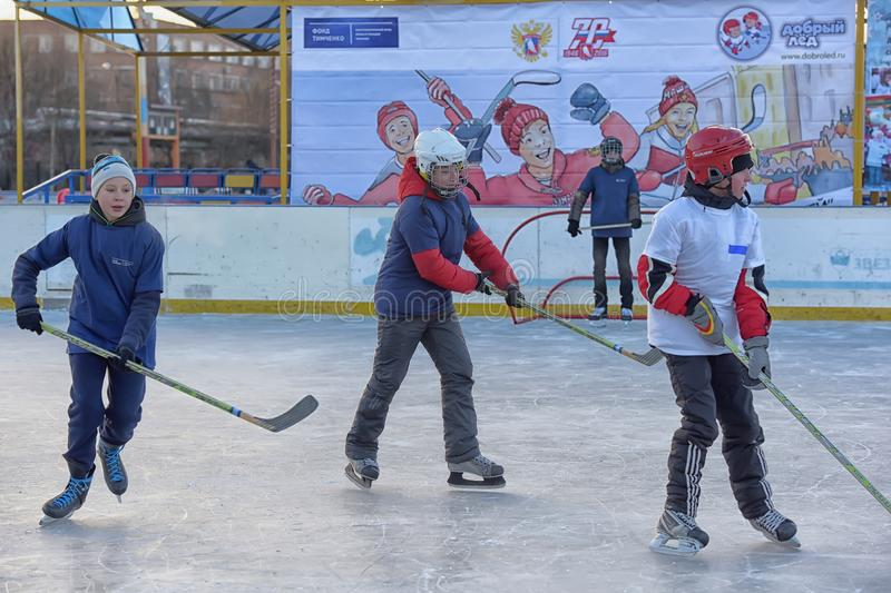 Children with hockey sticks playing hockey at the festival. Russia, Severodvinsk 27,11,2016 Children with hockey sticks playing hockey at the festival `Hockey stock photo