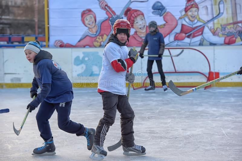 Children with hockey sticks playing hockey at the festival. Russia, Severodvinsk 27,11,2016 Children with hockey sticks playing hockey at the festival `Hockey stock image