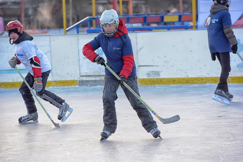 Children with hockey sticks playing hockey at the festival. Russia, Severodvinsk 27,11,2016 Children with hockey sticks playing hockey at the festival `Hockey stock photos