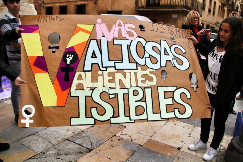 Children holding banner against gender violence in demonstration stock photo