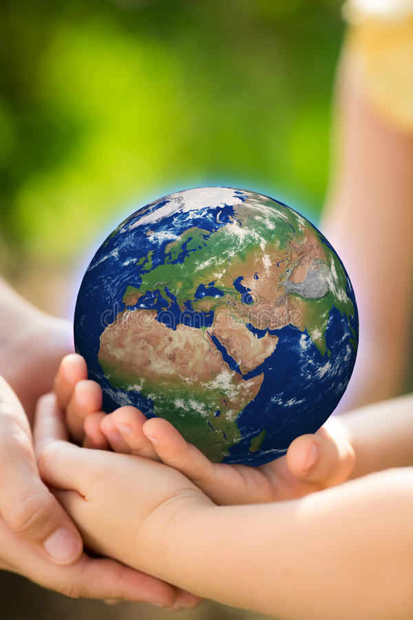 Children holding Earth in hands royalty free stock images