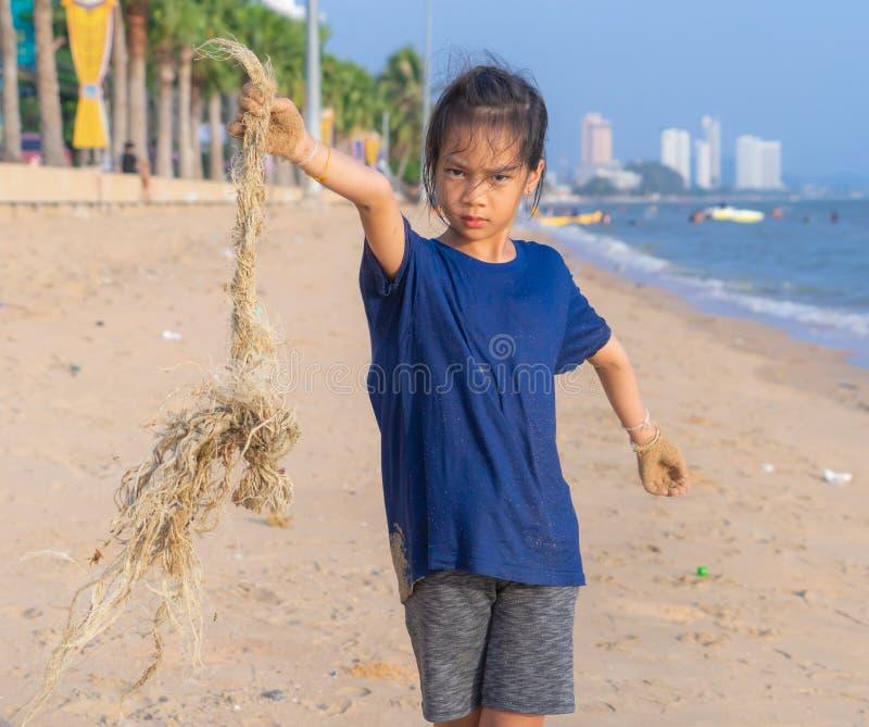 Children holding Fishing net watse that he found on the beach. Children is holding Fishing net watse that he found on the beach royalty free stock photo