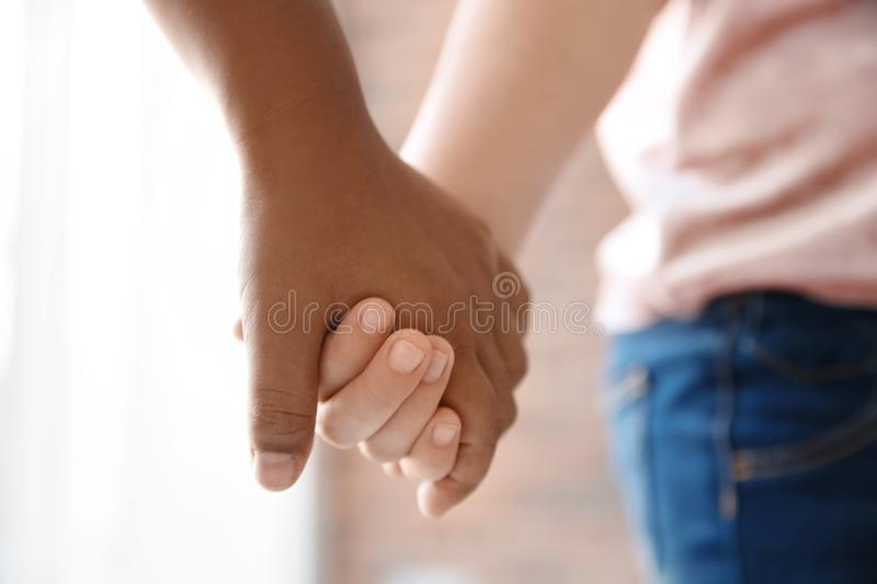 Children holding hands on blurred background, closeup. Unity concept royalty free stock photo