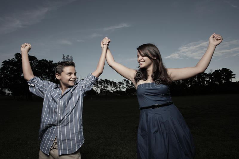 Download Children Holding Hands In The Park Stock Photo - Image: 10515192