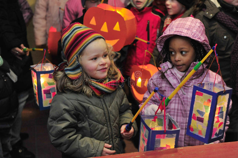 Children holding laterns stock image