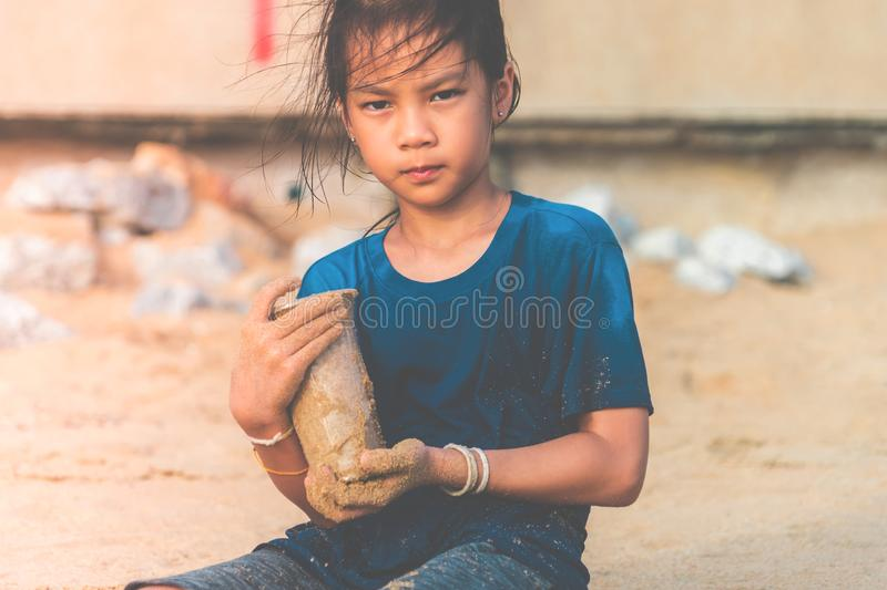 Children holding Plastic bottle that he found on the beach for enviromental clean up concept. Children is holding Plastic bottle that he found on the beach for royalty free stock photography