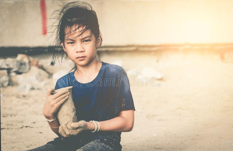 Children holding Plastic bottle that he found on the beach for enviromental clean up concept. Children is holding Plastic bottle that he found on the beach for stock photography