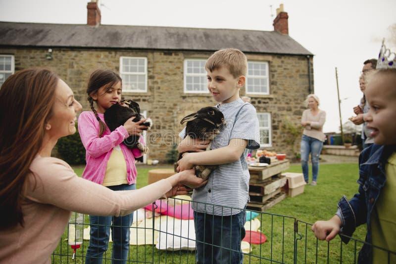 Children Holding Rabbits stock photos