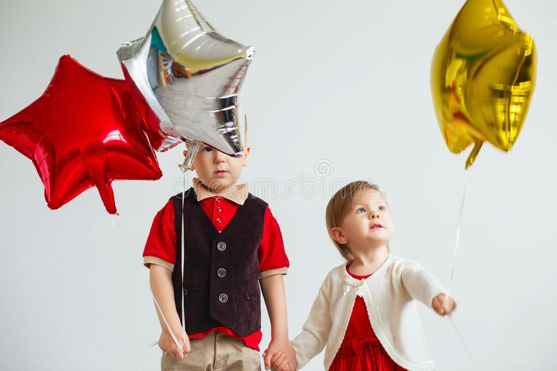 Children holding a star shaped balloons. stock image