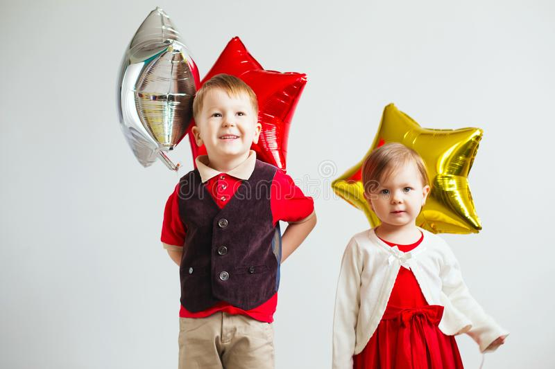 Children holding a star shaped balloons. stock photos