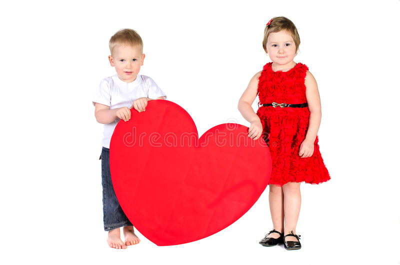 Children with huge heart made of red paper stock photos